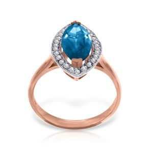 14K. GOLD RING WITH DIAMONDS & MARQUIS BLUE TOPAZ